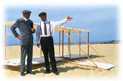 The Wright Brothers discuss flight conditions on the beach.