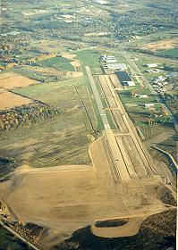 An aerial view of the airport showing the new taxiway and runway extension.