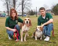 Members of the Michigan Pet Fund staff with two beagles.