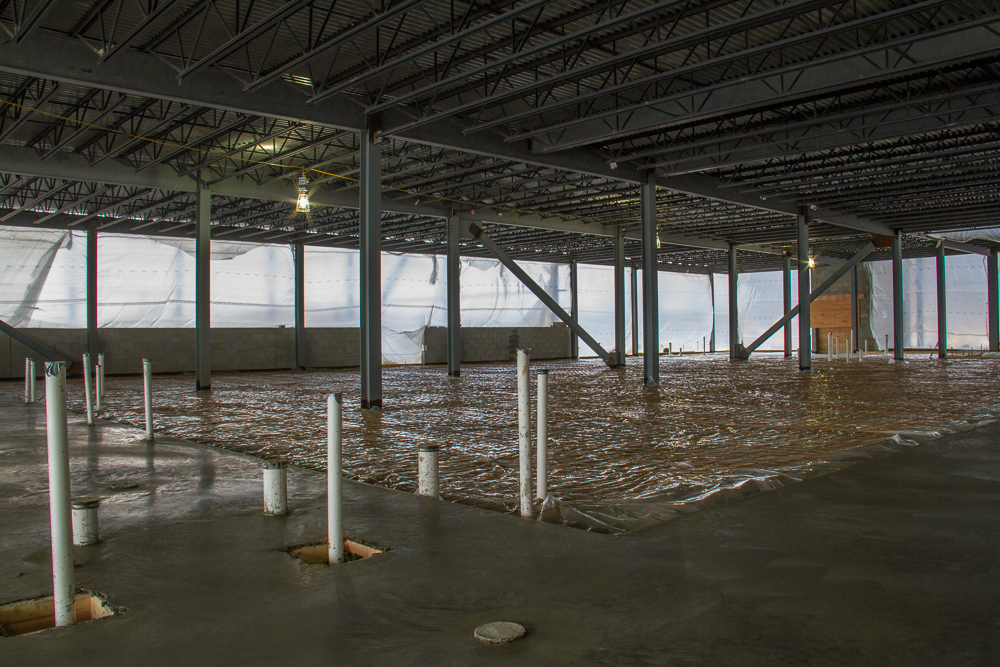 Inside view of EMS construction with partially filled concrete floors.